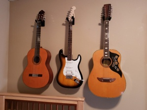 Guitars Hanging on Wall